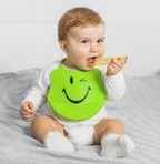 Infant eating cheese